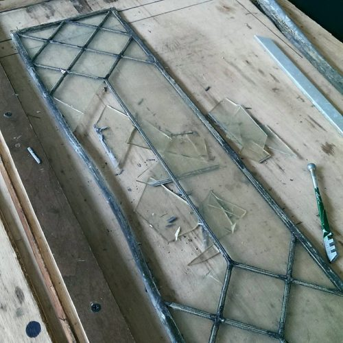 Leaded glass window being repaired.